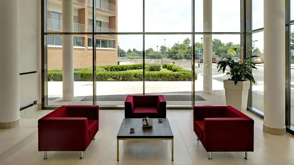 Tulip Inn Naples Airport - Edit_Lobby.jpg