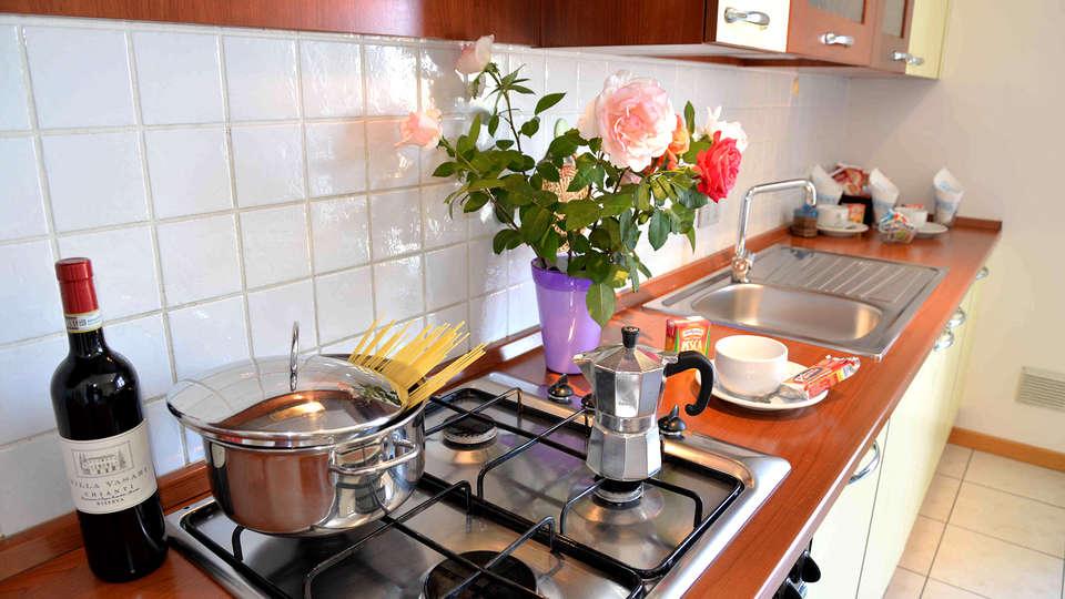 Residence Le Corniole Aparthotel - Edit_Kitchen.jpg