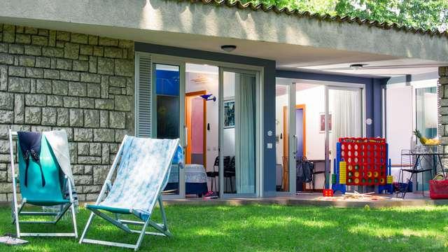 Relax e benessere a Riva del Garda in elegante bungalow con accesso alla spa incluso!