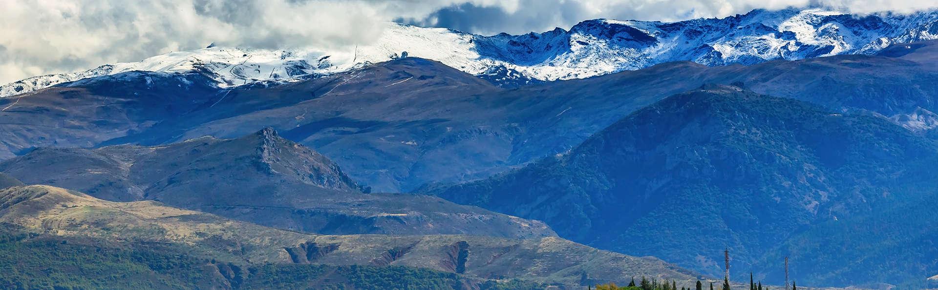 Escapada con botella de vino en el techo de España, inmerso en Sierra Nevada