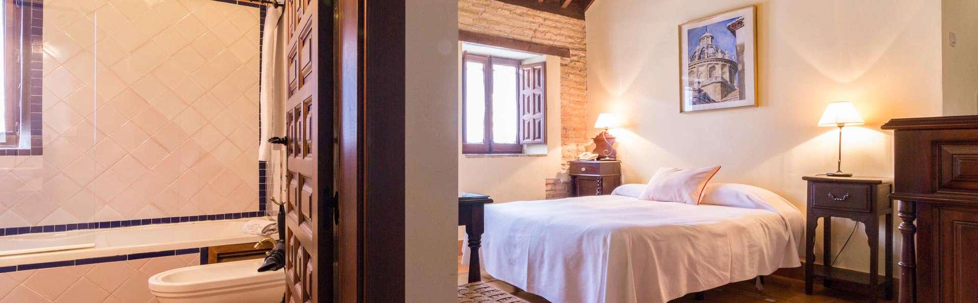 Granada sin aglomeraciones en un pequeño hotel boutique con copa en la habitación