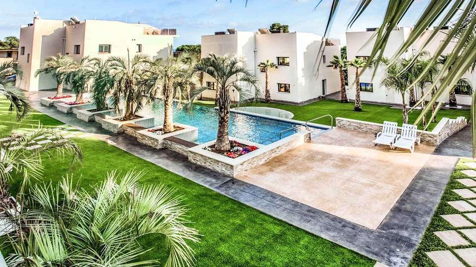 Calma Holiday Villas - EDIT_jardin______________08.jpg