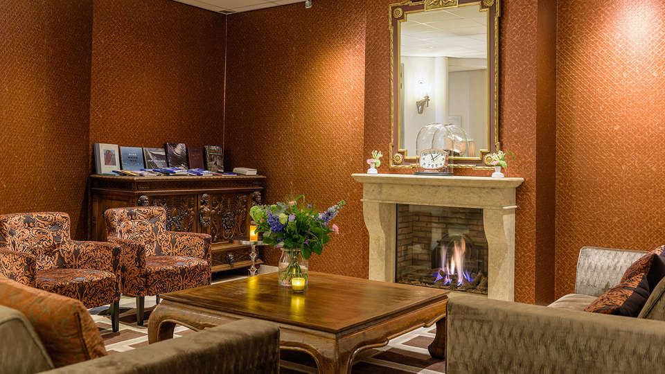 Golden Tulip Tjaarda Oranjewoud - EDIT_Hotellobby-Open-Haard-_3_.jpg