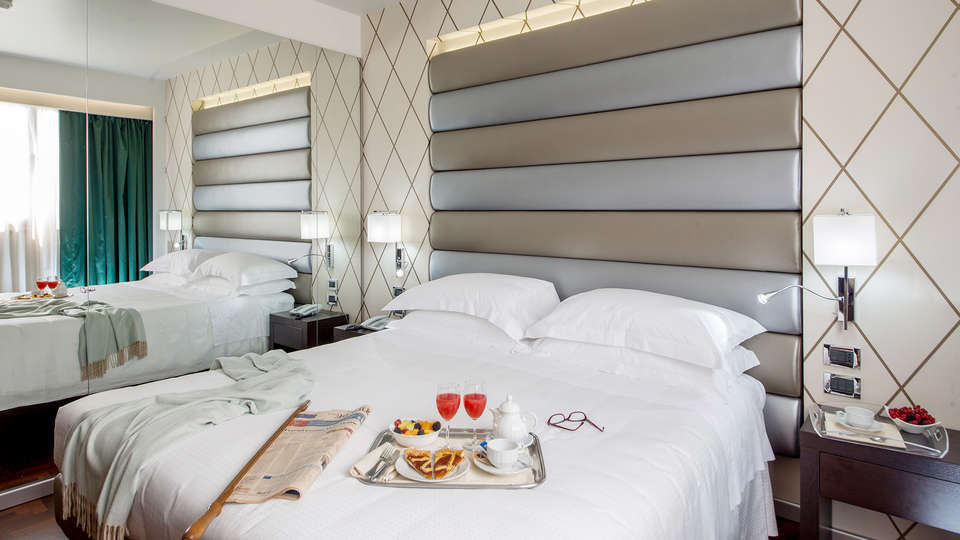 Enea Hotel - Edit_Room.jpg