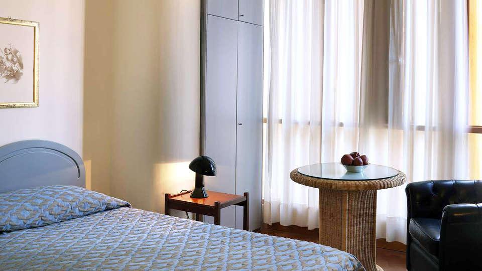 Hotel Palazzo Ricasoli - Edit_Room.jpg