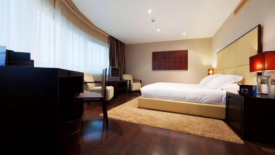 LangreHotel & Spa - EDIT_room.jpg