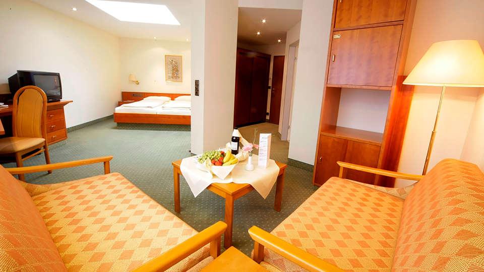 Dorint Seehotel & Resort Bitburg Südeifel - edit_Fichte_Wohnbereich.jpg
