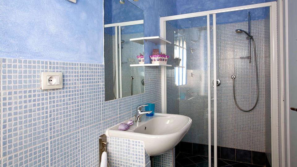 Baia de Bahas Exclusive Resort - Edit_Bathroom.jpg