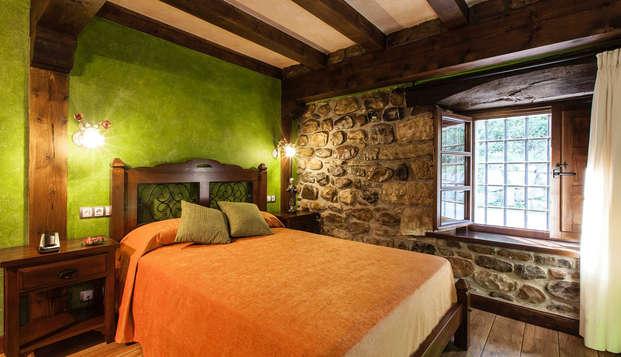 Escapade détente avec spa privé et bouteille de cava dans une chambre avec bain hydromassant