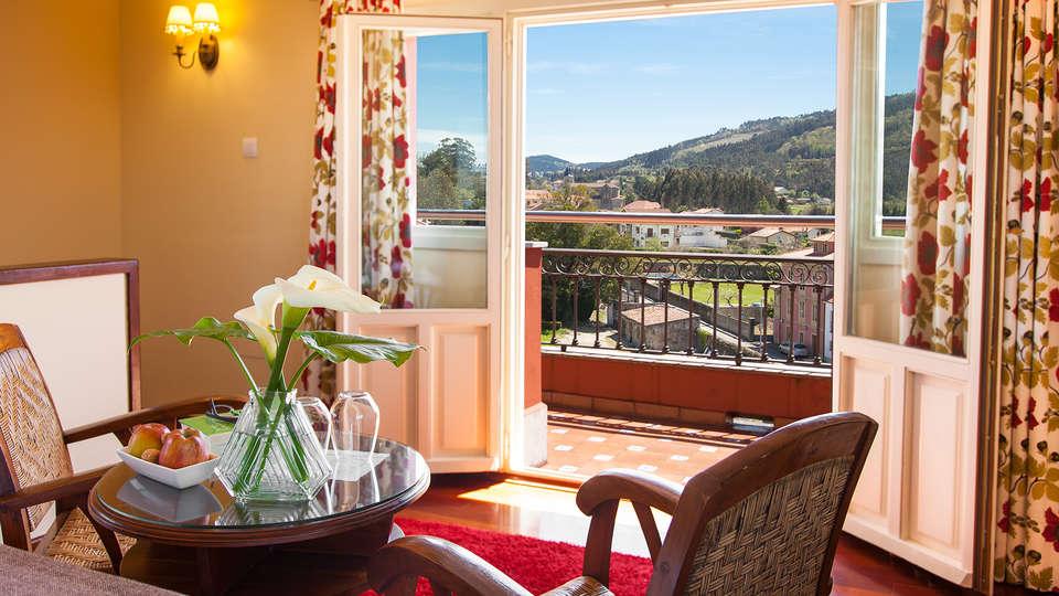 Hotel y Apartamentos Casona de la Paca - EDIT_room1.jpg