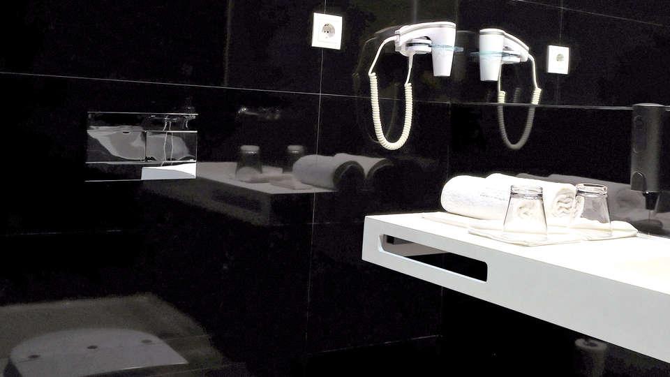 Open Village Sports Hotel & Spa Club - Edit_bathroom.jpg