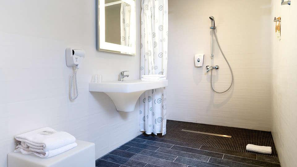 ibis Styles Nivelles - Edit_Bathroom3.jpg