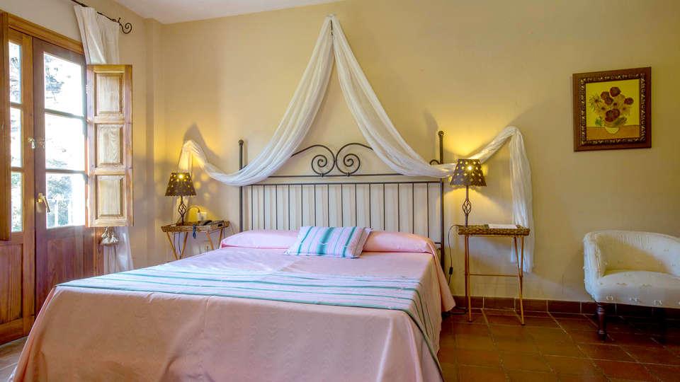Hotel Humaina - Edit_Room.jpg