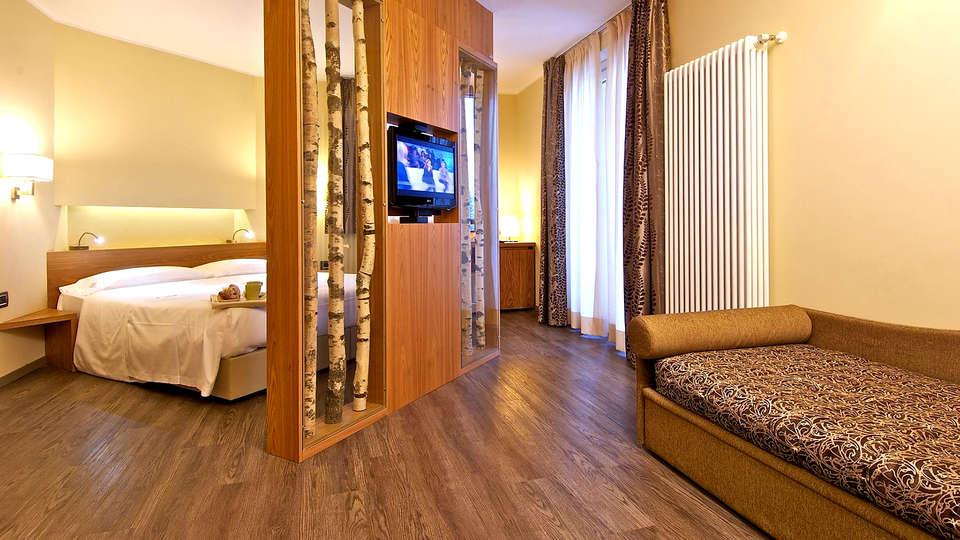Harmony Suite Hotel - Edit_Room3.jpg