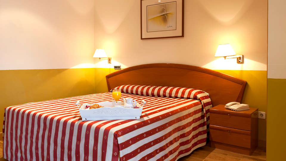 Hotel los Braseros - Edit_Room.jpg
