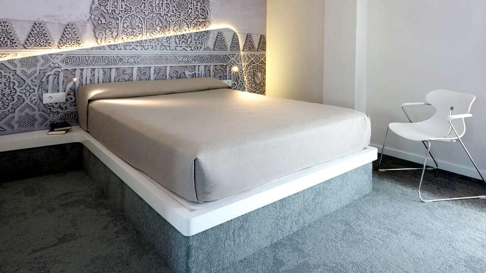 Granada Five Senses Rooms & Suites - Edit_Room8.jpg