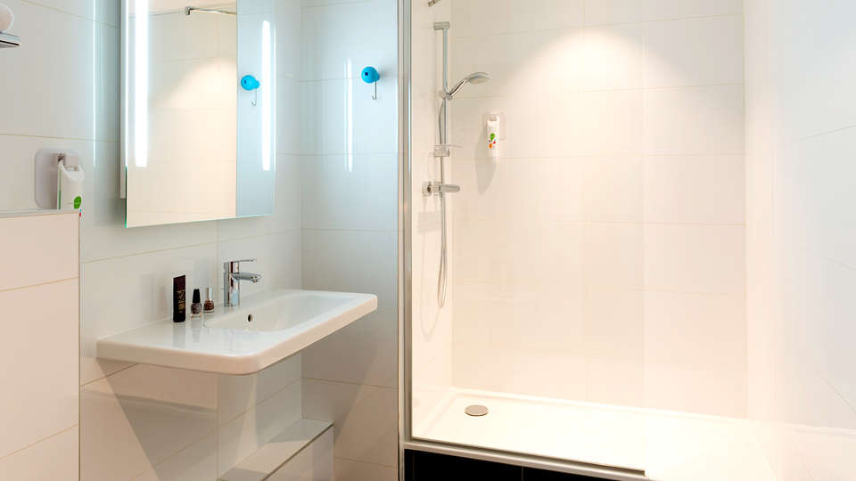 Ibis Styles Lyon Confluence - Edit_Bathroom.jpg